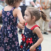 AMY SWEENEY/Staff photo. Sofia Godzik, 5, dances with her sister Katherine, 2, before the start of the  9/11 ceremony at New Brothers Restaurant and Deli in Danvers. 9/11/16
