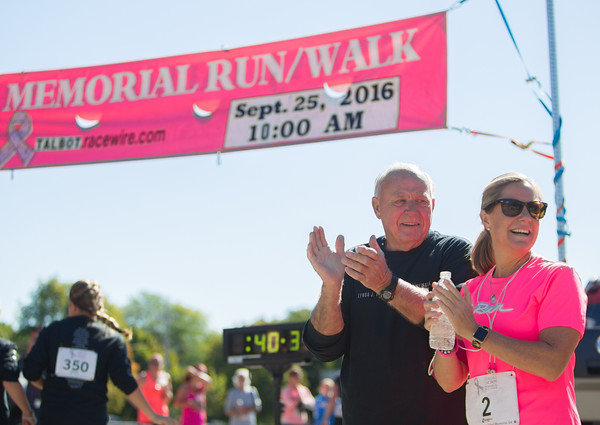 Jared Charney / Photo Bruce Talbot (husband of the late Lynda Talbot) along with Karen Donnelly cheer on the participants at the 6th Annual Lynda J. Talbot 5K run/walk, Sunday, September 21, 2016.