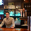 RYAN HUTTON/ Staff photo<br /> Michael Manzi tends bar at the Essex Street Grill.