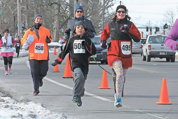 TIM JEAN/Staff photo <br /> Despite the cold hundreds came out to run the annual Valentine's Day Road Race in Bradford.       2/13/16