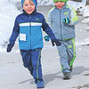 TIM JEAN/Staff photo <br /> Joey Munroe, 3, left, and his twin brother Charlie run along the sidewalk of Salem Street, as they try to get in front of the racers before the start of the annual Valentine's Day Road Race in Bradford.       2/13/16
