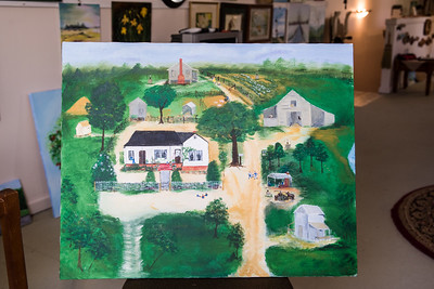 A folk art style painting Linda created from memory of her crandparents property.