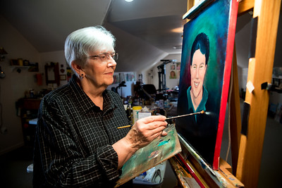 Linda works on a painting of her daughter.