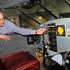 TIM JEAN/Staff photo<br /> Wendell Berthelsen, Director of Operations explains the cockpit controls of a Embraer 110 fuselage on display at Aviation Museum of New Hampshire in Londonderry.   Visitors can walk in and sit at the controls while learning about the aircraft.     5/25/16