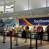 TIM JEAN/Staff photo<br /> People check in at the Southwest terminal at Manchester Boston Regional Airport in Londonderry.   6/28/16