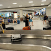 TIM JEAN/Staff photo<br /> Air passengers pick up their luggage in the terminal of Manchester Boston Regional Airport in Londonderry.   6/28/16