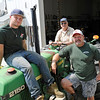 TIM JEAN/Staff photo<br /> Three generations of Sunnycrest farmers Danny, left, Daniel Hicks II driving the tractor, and Dan near the workshop of Sunnycrest Farm in Londonderry. 7/20/16