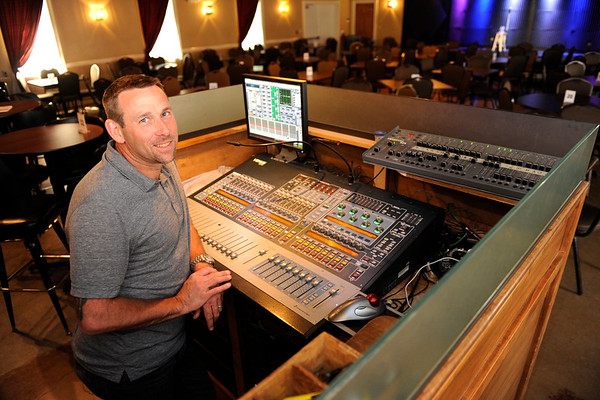 TIM JEAN/Staff photo<br /> Scott Hayward, owner of Tupelo Music Hall in Londonderry stands behind the mixing board as he tests out the microphone before a show. 5/26/16