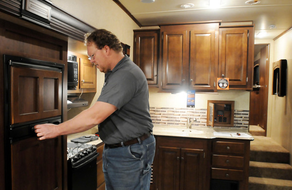 Technician Chad Lachmiller checks out the gas system of a new RV.