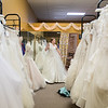"Heather Grewe tries on wedding dresses at Encore Consignment and Bridal Boutique in the Old Town district of Mankato. Owner Kim Stanton said her wedding dresses range from $150 up to $2,000, with the average price being $699. Heather's mother Amy Grewe said of the final dress choice, ""We're fully paying it of and taking it home."" Photo by Jackson Forderer"