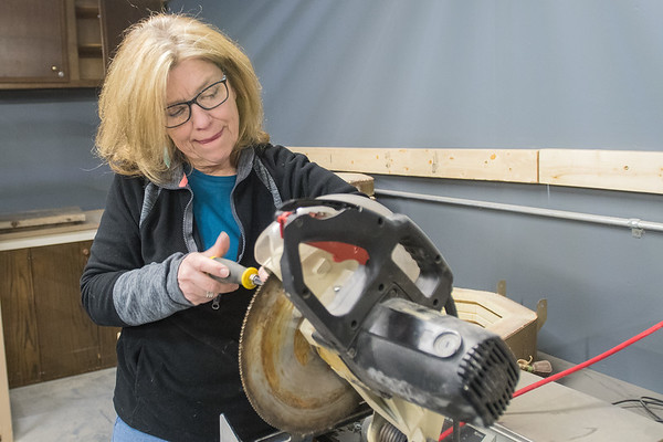 Cindy Bourne fixes a guard for a circular saw at Mankato Makerspace. The warehouse space for the organization that recently opened is at the intersection of 3rd Avenue and Pine Street in Mankato. Photo by Jackson Forderer