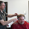 """Rolland Wright gets a haircut from Mac's for Hair owner Kevin """"Mac"""" Ayers at the newly opened shop on Madison Avenue in Mankato."""