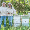 Jason Moody and Kaylee Carnahan of Moody Bees Honey at one of their bee yards in rural Judson. They have been in business for four years and sell their honey at the Mankato Farmer's Market and at both Hy Vee locations in Mankato. Photo by Jackson Forderer