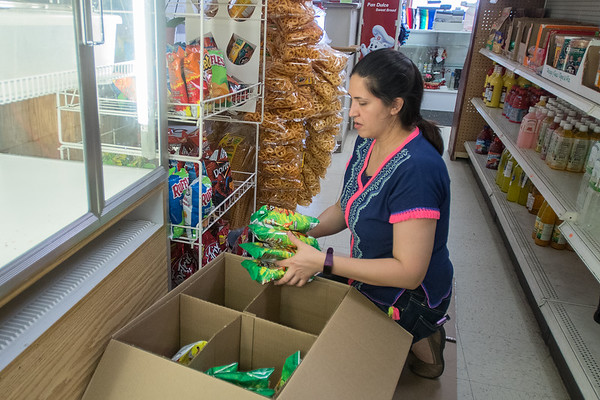 Goretti Enrrigue stocks the shelves at Jalisco Market in downtown Gaylord.