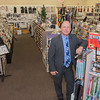 Joe Meidl, owner and president of Music Mart. Music Mart first opened in Mankato in 1991. The store sells instruments and sheet music, repairs instruments and gives music lessons. Photo by Jackson Forderer