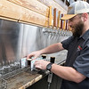 Caleb Fenske prepares a flight of sample beers at Lost Sanity Brewing. The brewery, with other local bars and breweries, is participating in the Southern Minnesota Brew Path. Photo by Jackson Forderer