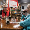 Ellen Morrow (right) takes a drink from a darker beer while trying a flight of samples with friend Sharon Dexheimer (left) at Lost Sanity Brewing. It was their first time visiting the brewery in Madelia. Photo by Jackson Forderer