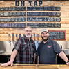 Caleb Fenske and Doug Fenske behind the bar at Lost Sanity Brewing in Madelia. Lost Sanity is one of the breweries participating in the Southern Minnesota Brew Path tour. Fenske said the Brew Path is a win for all parties involved; KEYC will sell the advertising for the Brew Path booklet, breweries sell the booklet and customers get their money back after visiting only two locations on the tour. Photo by Jackson Forderer