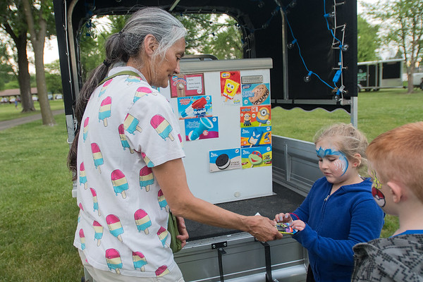 Elaine Hardwick (left) gives ice cream to Madalynn Maloney, 5, after she decided on a Teenage Mutant Ninja Turtle themed treat. Photo by Jackson Forderer