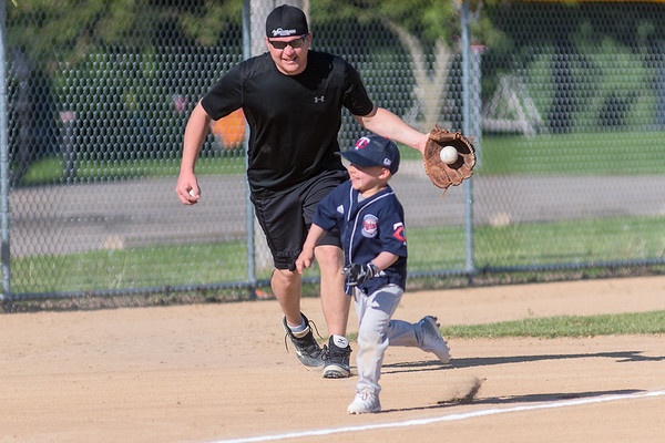Mason Nessler, 4, is chased down the third base line towards home plate by Scott Nessler before a softball game began at Jaycee Park. Photo by Jackson Forderer