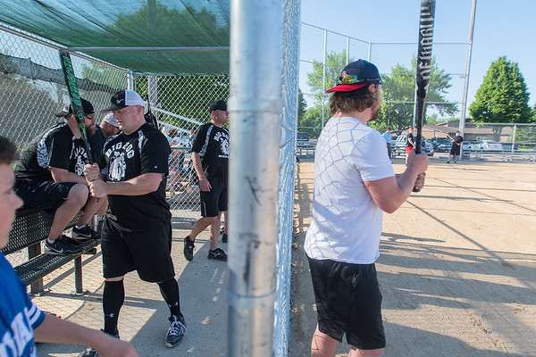 Tony Vetter (right) and his teammates on the Big Dog softball team get warmed up before a game at Jaycee Park. Photo by Jackson Forderer