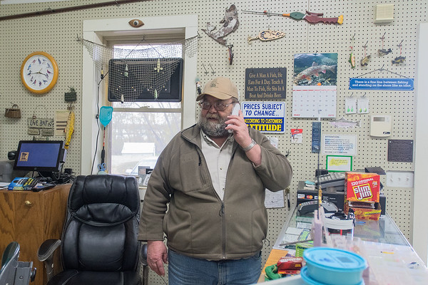 Walt Hohn, owner of Walt's Hook, Line and Sinker bait shop talks on the phone in his store in rural St. Peter. Photo by Jackson Forderer