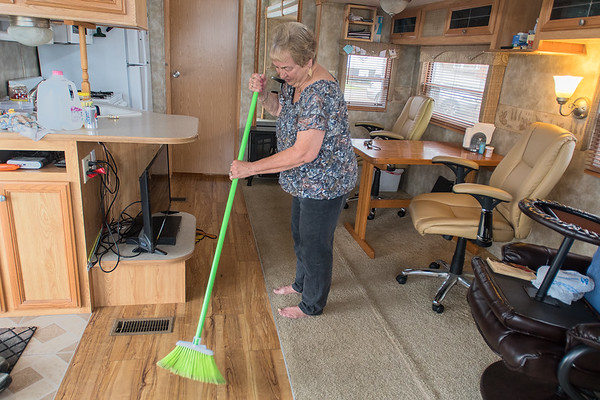 Jan Hommerding from Otsego sweeps in her RV at Lakeview Resort. Hommerding said that she and her husband have been coming to the resort for 11 years and they like to go pontooning and listen to cowboy music. Photo by Jackson Forderer