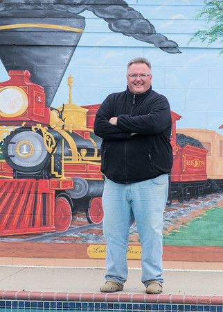 Bill Byrne, who has owned Lakeview Resort since 2011, in front of a mural of the first steam train to come through Minnesota, whose conductor was Byrne's grandfather. Photo by Jackson Forderer