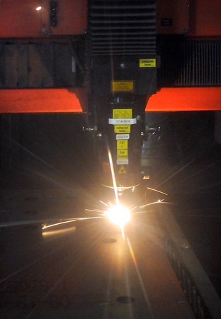 Laser cutting parts out of a metal sheet. Photo by Pat Christman
