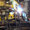 Robotic welder welding a plow blade. Photo by Pat Christman