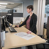 Staci Flemming, a senior interior designer with ISG, works at her standing desk in the company's downtown Mankato offices. Flemming said she loved working on the recently opened St. Peter High School and is currently working on projects for Mayo Clinic Health System. Photo by Jackson Forderer
