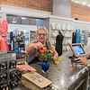 Sharon Hubly (center) makes a few final adjustments to an artificial bouquet of flowers being purchased by Jean Anderson (left) as Marilyn Reinhart (right) rings up the purchase at Inspired in New Ulm. Photo by Jackson Forderer