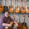 Eric Ouren of Ouren Instruments at his newly opened shop. He said his business will mainly repair guitars and banjos, but he also builds banjos and refurbishes older guitars.