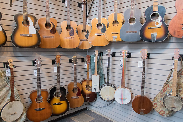 A wall of guitars and banjos at Ouren Instruments. The shop operated by Eric Ouren has opened in the Y Barbers building in North Mankato.