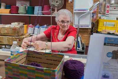 Kay Carlson works on a knitting machine at Knit and Sew World in St. Peter. Amanda Young, who works at the store, holds knitting classes on the first two Saturdays of each month and an embroidery class on the third Saturday of every month. Photo by Jackson Forderer
