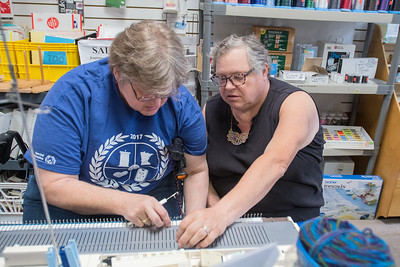 Amanda Young (right) helps out Jolene Vickers on a knitting machine at Knit and Sew World in St. Peter. Kay Carlson works on a knitting machine at Knit and Sew World in St. Peter. Young holds knitting classes at the business the first two Saturdays of every month. Photo by Jackson Forderer