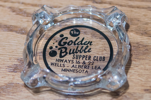 Jeff Erickson, owner of the Golden Bubble, said that his grandfather would put out ashtrays when he owned the event space but those ashtrays would be stolen. Over the years the logo changed, but the original logo shown here, is now being used by Erickson.