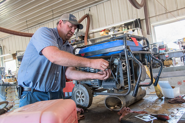 Bryon Schultz works on a generator in the repair shop at Dranttel Sales and Service in St. Peter. The business sells and repairs boats, side by sides, four-wheelers and generators.