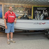 Lee Gansen alongside a fishing boat at Dranttel Sales and Service in St. Peter. The business is in its 53rd year.