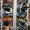 A rack of helmets for sale at Vetter Sales and Service in Kasota. The business sells Polaris snowmobiles, ATVs, helmets, side by sides and other accessories. Photo by Jackson Forderer