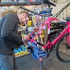 Aaron Buege works on a woman's road bike at Nicollet Bike Shop. Photo by Jackson Forderer