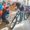 Charley Serrill (left) helps Nathan Gassman check out fat tire bikes at Nicollet Bike Shop. Photo by Jackson Forderer
