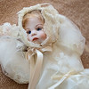 A porcelain doll that was completely made by Mary Hale, including the porcelain head, dress, painted on makeup and hair from her grandchild. Hale said her favorite type of clothing to make for dolls is formal wear. Photo by Jackson Forderer