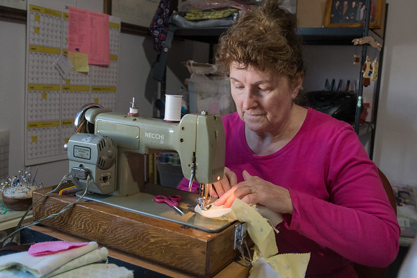 Mary Hale, owner of La Petite Boutique, sews a night gown for a doll on a sewing machine given to her by her mother, at her home in Mankato. Hale makes clothing for various kinds of dolls including Barbie and American Girl. She has been sewing for 54 years. Photo by Jackson Forderer