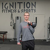 Jason Tompkins, owner of Ignition Fitness and Sports, with a kettlebell in the main room of the athletic facility in North Mankato. Ignition has been in their new building on Commerce Drive for a little over a year and they now have seasonal interns from Gustavus and Minnesota State. Photo by Jackson Forderer
