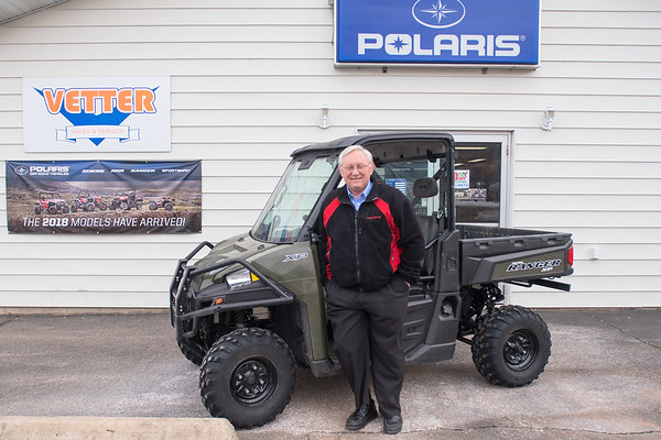 """Jerry Vetter, owner of Vetter Sales and Service, has been selling Polaris vehicles and products since 1964 in Kasota. He said that his sales of side-by-side vehicles has grown leaps and bounds, and added, """"If five years ago someone would've said we would sell this many side-by-sides, I wouldn't believe them."""" Photo by Jackson Forderer"""