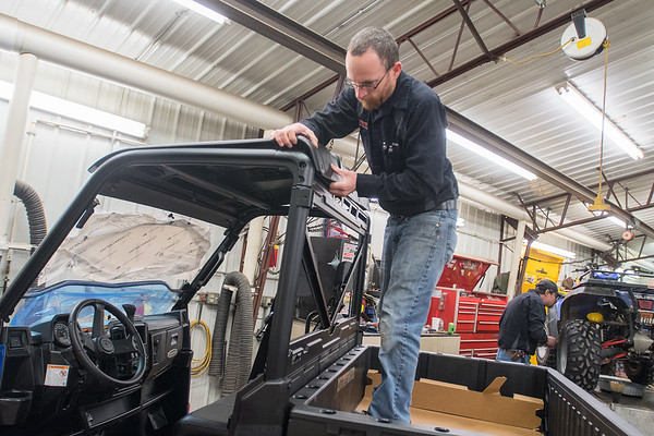 Jesse Allen puts a canopy on a Polaris side-by-side at Vetter Sales and Service in Kasota. Vetter does repairs on all Polaris vehicles. Photo by Jackson Forderer