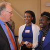 City Desk, North Andover:  Dr. Christopher Hopey, president of Merrimack College, North Andover,  with Lawrence High School Class of 2012<br /> students who participated in the program, at left, Milly Joseph and Gladys Gitau, both of Lawrence,<br /> at the Merrimack Valley Sandbox Initiative Celebration Campus Catalyst, Thursday, at Merrimack College, North Andover.<br /> 5-5-11,  Photo by Frank J. Leone, Jr.