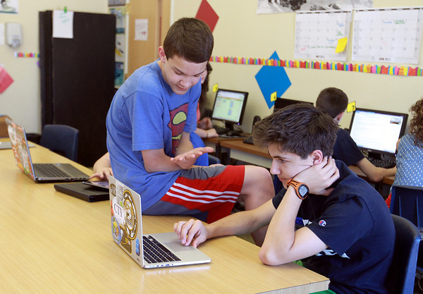 Ethan Calandra and Jack Lawlor are on the eighth grade team at Hampstead Academy that won a national mobile app design competition and had the opportunity to work with the Massachusetts Institute of Technology Media Lab. <br /> Photo by Amy Sweeney
