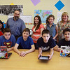 A team of eighth grade students from Hampstead Academy are winners of a national competition to develop mobile applications that address a need or problem in their school community. They are front row from left Ethan Calandra, 14, from Windham, Alex Mielens, 14, from Danville, Nathan Stallings, 14, from Chester, Jack Lawlor, 14, from Salem, N.H.<br /> Back: Ashvi Patel, 14, Methuen, MA, Chris Sousa, faculty adviser, Sarah Miller-Bartley, 14, South Hampton, Rachel Fonseca, 13, Haverhill and Christina DiMicelli, faculty adviser.<br /> Photo by Amy Sweeney